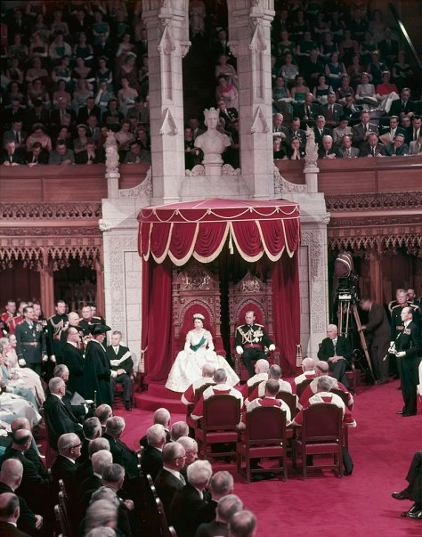 800px-Queen_Elizabeth_II_and_Prince_Phillip_sit_on_thrones_before_a_full_Parliament